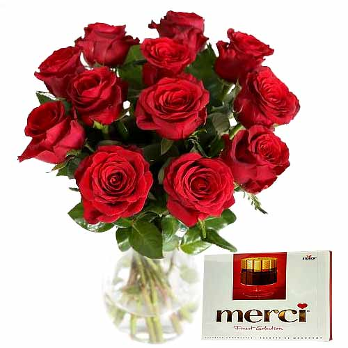 Attention-Getting 12 Red Roses in Vase with Merci Chocolates