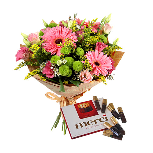 Expressive Love Treat Seasonal Mixed Flower Bouquet with Merci Chocolates