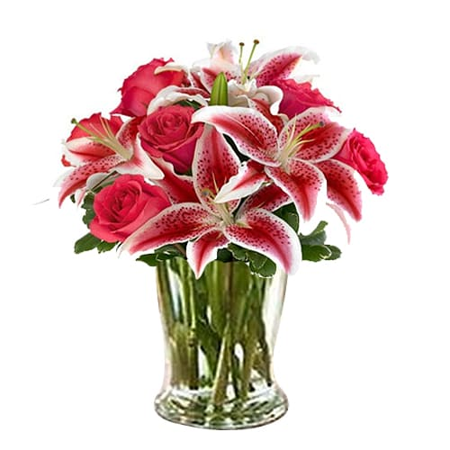 Cheerful Arrangement of 3 Pink Lilies and 5 Red Roses with Vase